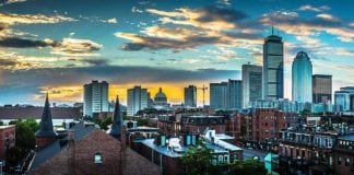 A view of the downtown Boston skyline during dusk, representing moving your business out of Boston.